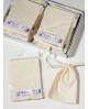 Natūralios spalvos medvilniniai maišeliai 10x15cm su 1cm pločio virvute.